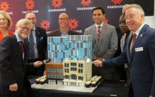 Fanshawe College President Peter Devlin (right) and other politicians and dignitaries cut a cake shaped like the college's new building at 130 Dundas St., at its grand open, September 14, 2018. (Photo by Miranda Chant, Blackburn News)