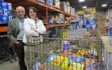 London Food Bank Co-Executive Directors Glen Pearson and Jane Roy surrounded by donations at the food bank warehouse on Leathorne St., September 27, 2018. (Photo by Miranda Chant, Blackburn News)