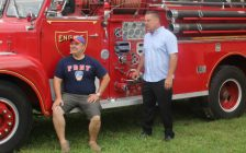 Brent DeNure (left) and Keith Chinnery (right) pose by one of the many classic fire trucks to be featured in the seventh and final Firefest later this month. September 6, 2018. (Photo by Greg Higgins)