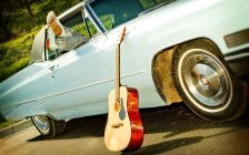 Cars and guitar photo by elljay from pixabay.