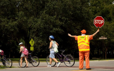 A crossing guard helps residents cross the street in Charleston, South Carolina. (Photo by U.S. Air Force photo/Airman 1st Class Nicholas Pilch)