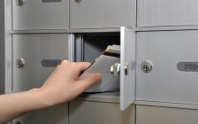 Woman removes letters from mailbox. File photo courtesy of © Can Stock Photo / payphoto.