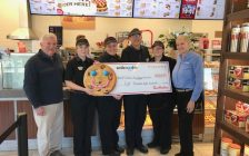 Thamesville Tim Hortons employees present Allan Davies with the Chatham-Kent School Nutrition Program a cheque from their Smile Cookie campaign. Photo provided.