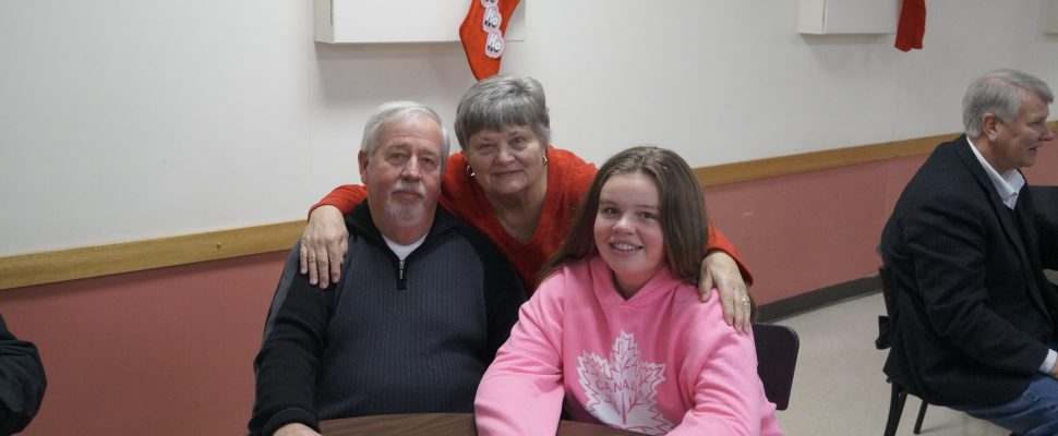 Grade 8 student Haley McKinlay alongside grandparents Liz Haley and Bob Haley at the Operation Christmas Tree kickoff. November 15, 2018. (Photo by Colin Gowdy, BlackburnNews)