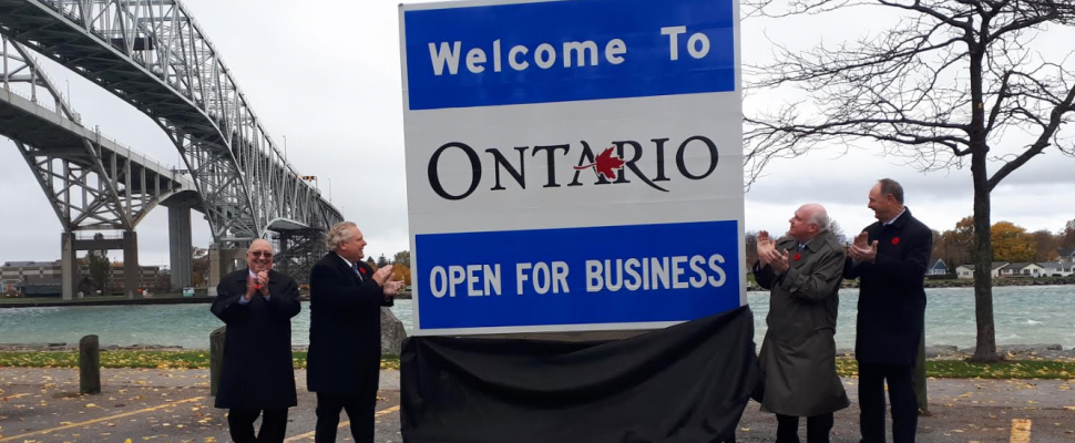 """Premier Doug Ford unveiling an """"Open For Business"""" sign in Point Edward alongside Sarnia-Lambton MPP Bob Bailey, Minister of Economic Development, Job Creation and Trade Jim Wilson, and Minister of Transportation John Yakabuski. November 2, 2018. (Photo by Colin Gowdy, BlackburnNews)"""