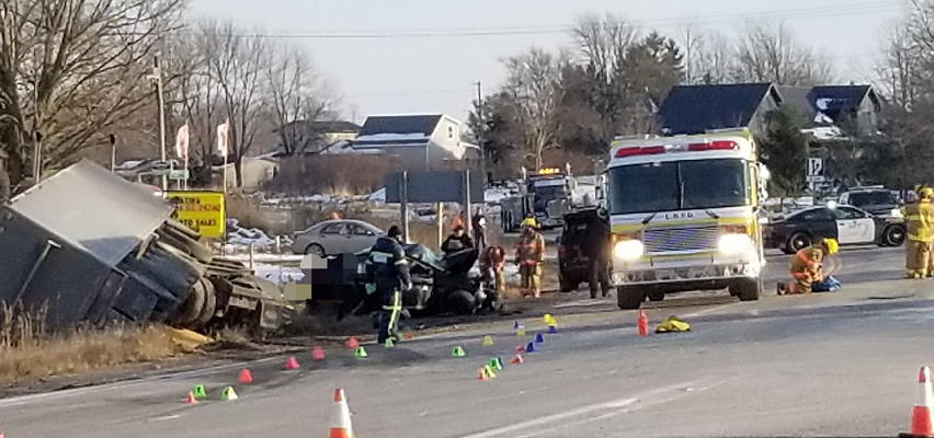 A sedan and transport truck collided on Richmond Street at Denfield Road, November 23, 2018. Photo courtesy of Middlesex OPP.