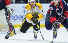 Sting forward Jacob Perreault going for the puck against Spitfires defenceman Connor Corcoran. December 7, 2018. (Photo by Metcalfe Photography)
