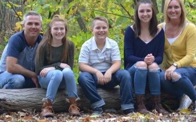 The Stewart family of Sarnia. Ansley (sitting beside her mom far right) will receive brain tumour treatment in 2019 in Texas (Photo via. GoFundMe.com)