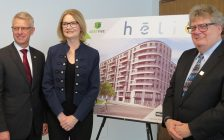 President of Sifton Properties Richard Sifton, London West MP Kate Young, and London Mayor Ed Holder stand in front of a rendering of the Helio highrise, January 22, 2019. (Photo by Miranda Chant, Blackburn News)