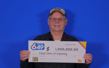 Llyod Shea of Plympton-Wyoming with his $1-million Lotto 649 cheque. January 2019. (Photo by OLG)