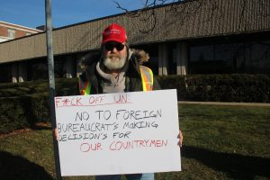Mike Nemeth holds a sign at the Yellow Vest demonstration in Windsor on January 5, 2019. (Photo by Adelle Loiselle)