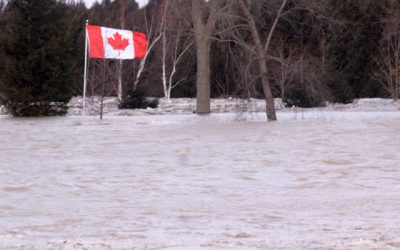 A Canadian flag still stands as River waters take over residential properties. February 8, 2019. (Photo by Greg Higgins)