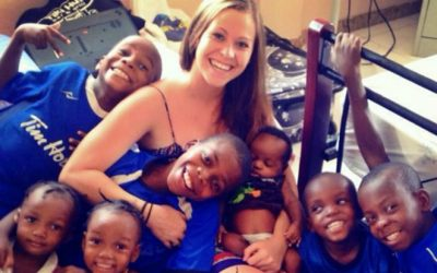 Emily Hime with Haitian children at the childrens home she operates in Haiti. (Photo courtesy of www.himeforhelp.org)