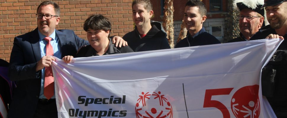 Knights of Columbus members along with police and athletes hold the Special Olympics flag outside the Civic Centre in Chatham before it gets flown at the courthouse. March 25, 2019. (Photo by Greg Higgins)