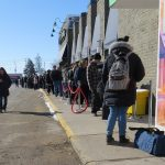 Dozens of people line up for the grand opening of Central Cannabis at 666 Wonderland Rd., April 1, 2019. (Photo by Miranda Chant, Blackburn News)