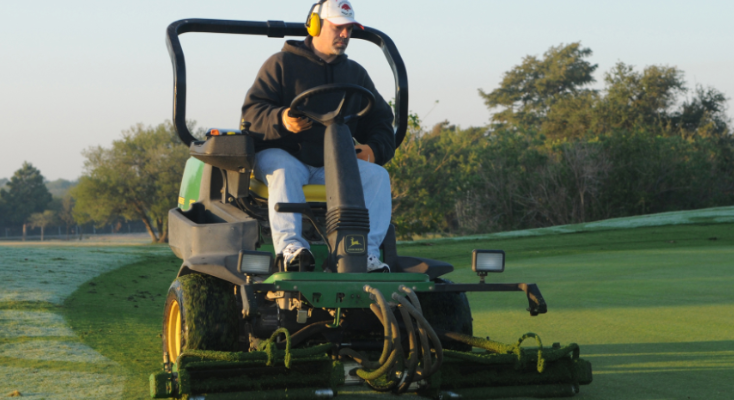 Golf course worker mows greens at Randolph Oaks Golf Course. (U.S. Air Force photo by Don Lindsey)