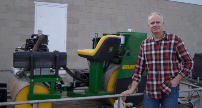 Plympton-Wyoming inventor Jason Cates stands next to his Rollinator. April 3, 2019. (Photo by Colin Gowdy, BlackburnNews)