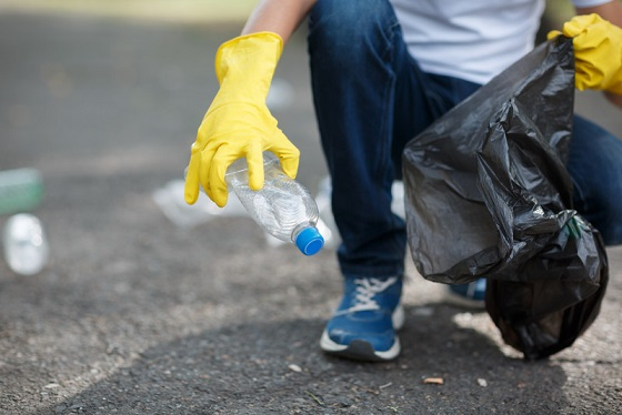 File photo of a person picking up litter courtesy of © Can Stock Photo / AlfaStudio.