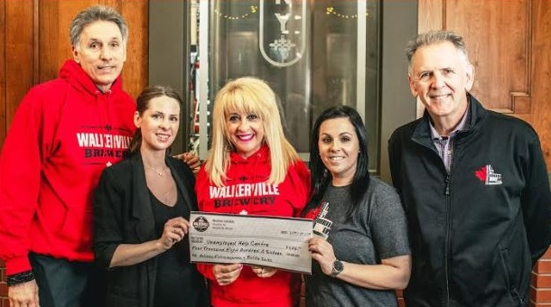 Staff at Walkerville Brewery present a cheque to the Unemployed Help Centre. (Photo courtesy of Walkerville Brewery)
