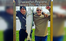 Robert Brunet (right) next to a 19.01 lb. salmon caught in the 2019 Salmon Derby. May 4 2019. (Photo by Bluewater Anglers)