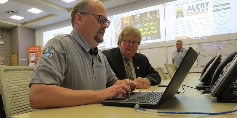 Andre Beauregard of London's emergency management department assists Mayor Ed Holder sign up for the alert London notification system, May 6, 2019. (Photo by Miranda Chant, Blackburn News)