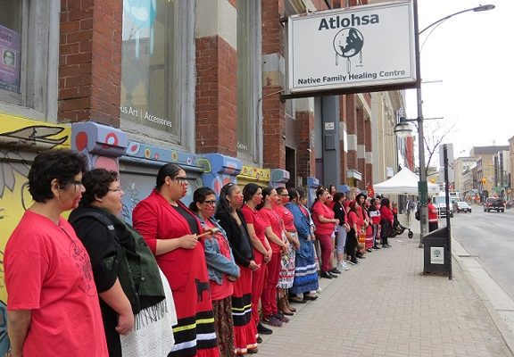 Dozens of Indigenous women stand in silence outside of Atlohsa Family Healing Services at 343 Richmond St., May 6, 2019. (Photo by Miranda Chant, Blackburn News)