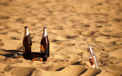 Beer bottles on a beach. (Photo from Pexels)
