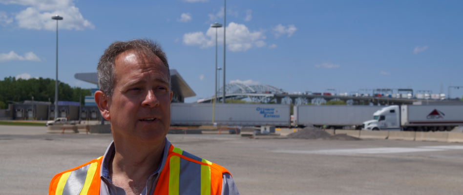 Federal Bridge Corporation Limited Director of Communications Todd Kealey with Blue Water Bridge in the backgroud. June 11. 2019. (BlackburnNews photo by Colin Gowdy)