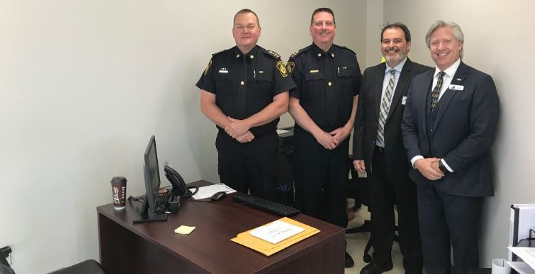 (Left to right) Sarnia Police Chief Norm Hansen, Deputy Chief Owen Lockhart, CRC Manager Brent Gillen and Accident Support Services Ltd. Vice President of Insurance Programs Rick Yates stand in Sarnia's new Collision Reporting Centre. June 11, 2019 Photo by Melanie Irwin.