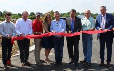 A ribbon cutting is held to kick off construction on a massive home building project in Chatham, June 19, 2019. (Photo by Allanah Wills)