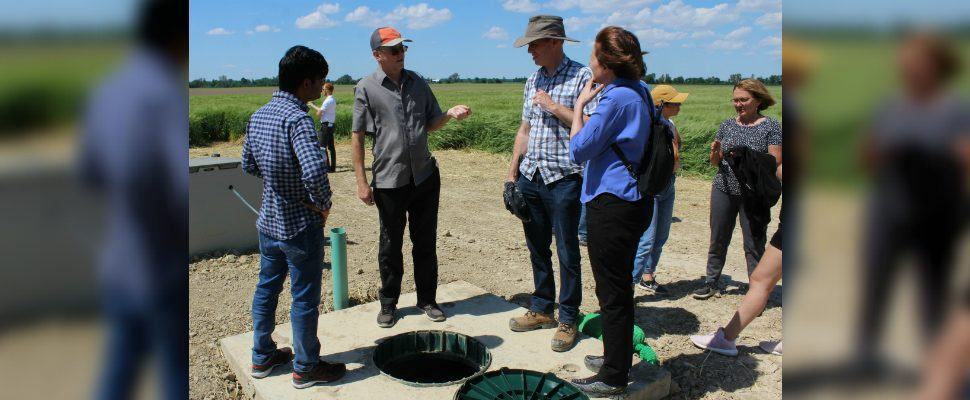Charlie Lalonde with the The Thames River Phosphorus Reduction Collaborative, talks to a group during a demonstration at Roesch Farm in Kent Bridge on Wednesday, June 26, 2019. (Photo by Allanah Wills)
