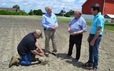 (Left to right) Farmer Emery Huszka shows soil conditions to Ontario's minister of agriculture Ernie Hardeman during a visit with Sarnia-Lambton MP Bob Bailey and Enniskillen Township Mayor Kevin Marriott. June 25, 2019 Submitted photo.