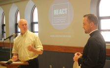 Bob Cameron, executive director of the Downtown Windsor Community Collaborative; and the Rev. Robert Clifford, rector of All Saints Anglican Church, unveil the new ReAct addiction recovery program on July 11, 2019. Photo by Mark Brown, Blackburn News.