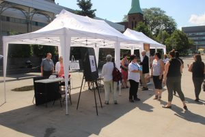 An information tent is set up by the Windsor-Essex Bilingual Legal Clinic in Charles Clark Square in Windsor, as part of the province-wide Day of Action, July 30, 2019. Photo by Mark Brown/Blackburn News.
