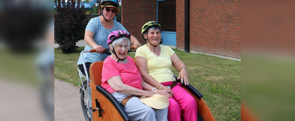 Residents at North Lambton Lodge in Forest take a ride on a trishaw. July 30, 2019. (Photo by County of Lambton)