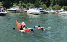 People in the water after their boat capsized at Pottahawk, July 14, 2019. Photo courtesy of Norfolk OPP.