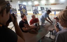 St. Louis Blues star Ryan O'Reilly signs autographs for fans at the Bayfield Arena. Photo by Bob Montgomery.