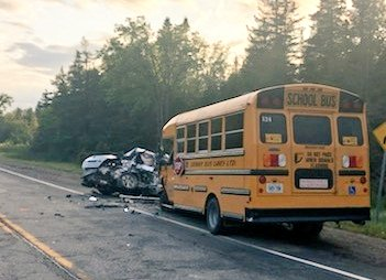 Emergency crews responded to a head-on crash between a car and a school bus on Wellington County Road 124 in Erin, August 15, 2019. (Photo courtesy of the OPP)
