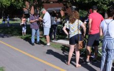 Community members gathered on Grande Avenue West for the unveiling of the new Greenfield Global trail. Photo by Michael Hugall)