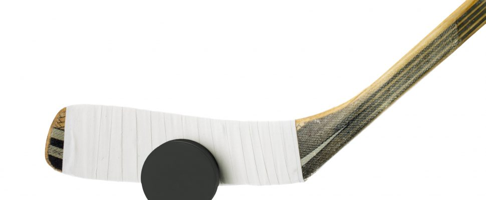 Hockey Stick and Puck. © Can Stock Photo / kozzi