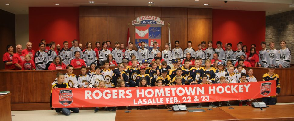 The LaSalle Vipers, in grey sweaters, join Lasalle Town Council, town administration and youth hockey players in unveiling LaSalle as a Hometown Hockey host, September 10, 2019. Photo by Mark Brown/Blackburn News.