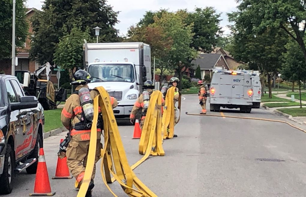 London firefighters lay out hose after responding to a gas leak in the area of Donnybrook Rd. and Phillbrook Dr. Photo from Twitter @LdnOntFire