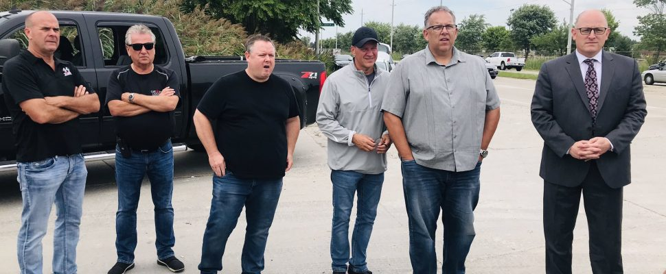 Unifor Local 200 president John D'Agnolo, third from right, Local 444 president Dave Cassidy, second right, and Windsor Mayor Drew Dilkens, far right, join union members outside the Nemak plant in Windsor, September 3, 2019. Photo courtesy Unifor Local 444/Twitter.