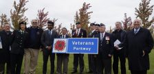 Local veterans and dignitaries gather in Heritage Park for the Veterans Parkway sign unveiling ceremony. October 16, 2019. (BlackburnNews.com photo by Colin Gowdy)