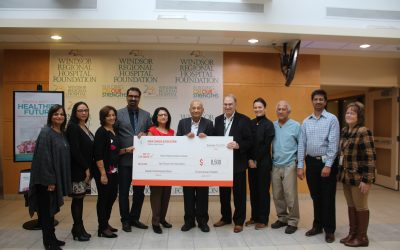 Members of the India Canada Association present a cheque to the Windsor Regional Hospital Foundation, November 21, 2019. (Photo by Maureen Revait)