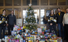 (From left to right) Ryan McGregor, David Legwand, Sam Bitten, Derian Hatcher, and Brad Webster stand next to a toy donation made by the Sting to the Salvation Army's Christmas Gift Hamper campaign. 26 November 2019. (BlackburnNews.com photo by Colin Gowdy)