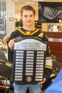 Sarnia Sting forward Jamieson Rees with the Teddy Bear goal-scorer plaque. November 5, 2019. (Photo by Sarnia Sting Hockey Club)