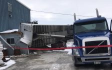 A damaged tractor-trailer is seen at Underground Specialties in Tecumseh, November 14, 2019. Photo provided by Ontario Provincial Police/Twitter.
