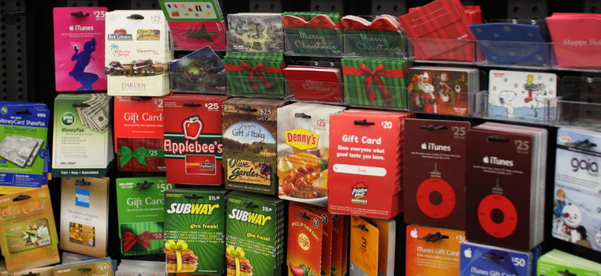 A display of gift cards at a Wal-Mart. December 22, 2008. (Photo by arvind grover from flickr)