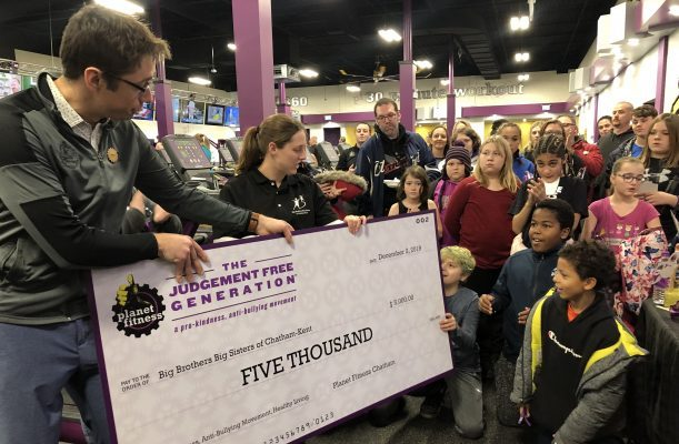 Planet Fitness in Chatham makes a $5,000 donation to Big Brothers Big Sisters during the gym's grand opening, December 2, 2019. (Photo by Allanah Wills, Blackburn News)